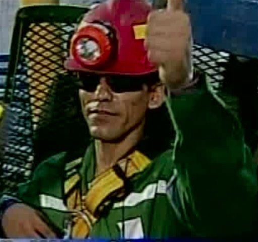 In this screen grab taken from video, Claudio Yanez, the eighth miner to be rescued, gives a thumbs up after his rescue Wednesday, Oct. 13, 2010 at San Jose Mine near Copiapo, Chile.  &#40;AP Photo&#41; <span class=meta>(AP Photo&#47; DG**NY** MM**NY**)</span>