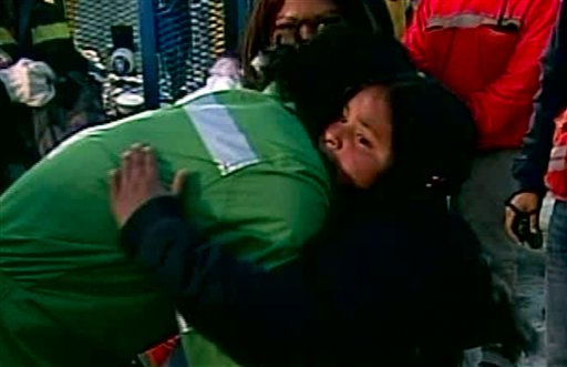 In this screen grab taken from video, Claudio Yanez, the eighth miner to be rescued, hugs a tearful relative after his rescue Wednesday, Oct. 13, 2010 at San Jose Mine near Copiapo, Chile.  &#40;AP Photo&#41; <span class=meta>(AP Photo&#47; DG**NY** MM**NY**)</span>
