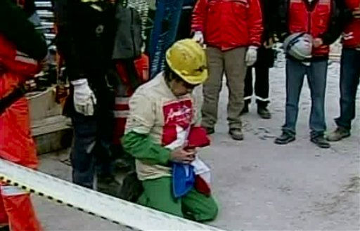 In this screen grab taken from video, Mario Gomez, the ninth miner to be rescued, kneels in prayer shortly after his rescue Wednesday, Oct. 13, 2010 at San Jose Mine near Copiapo, Chile.  &#40;AP Photo&#41; <span class=meta>(AP Photo&#47; DG**NY** MM**NY**)</span>