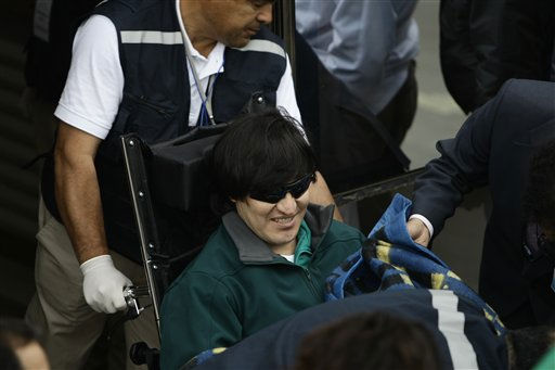 Rescued miner Carlos Mamani, from Bolivia, arrives to the hospital of Copiapo, Chile, Wednesday, Oct. 13, 2010. Mamani was the fourth of 33 miners who was rescued from the San Jose mine after more than 2 months trapped underground. &#40;AP Photo&#41; <span class=meta>(AP Photo&#47; Anonymous)</span>