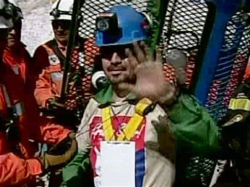 In this screen grab taken from video, miner Edison Pena waves after being rescued from the collapsed San Jose gold and copper mine where he had been trapped with 32 other miners for over two months near Copiapo, Chile, Wednesday Oct. 13, 2010. &#40;AP Photo&#41; <span class=meta>(AP Photo&#47; DG**NY** MM**NY** GM**NY**)</span>