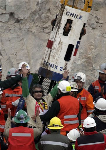Rescued miner Mario Gomez salutes after emerging from the capsule at the San Jose Mine near Copiapo, Chile Wednesday, Oct. 13, 2010. Gomez was the ninth of 33 miners who was rescued from the San Jose mine after more than 2 months trapped underground. &#40;AP Photo&#47;Jorge Saenz&#41; <span class=meta>(AP Photo&#47; Jorge Saenz)</span>