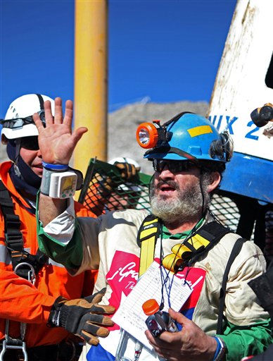 In this photo released by the Chilean government, Jorge Galleguillos, the eleventh miner rescued from the collapsed San Jose gold and copper mine waves to the crowd after been trapped with 32 other miners for over two months near Copiapo, Chile, Wednesday, Oct. 13, 2010.  &#40;AP Photo&#47;Hugo Infante, Chilean government&#41; <span class=meta>(AP Photo&#47; Hugo Infante)</span>
