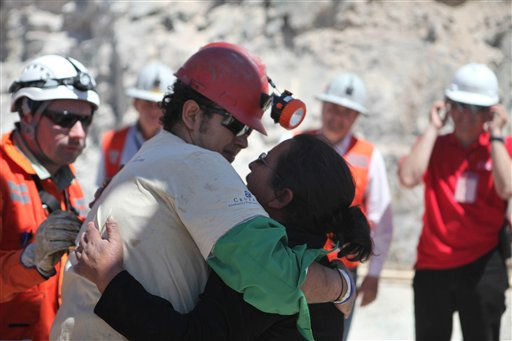 In this photo released by the Government of Chile, miner Daniel Herrera Campos embraces his mother after being rescued from the collapsed San Jose gold and copper mine, near Copiapo, Chile, Wednesday, Oct. 13, 2010. Herrera was the sixteenth of 33 miners rescued from the mine after more than 2 months trapped underground. &#40;AP Photo&#47;Hugo Infante, Government of Chile&#41; <span class=meta>(AP Photo&#47; Hugo Infante)</span>