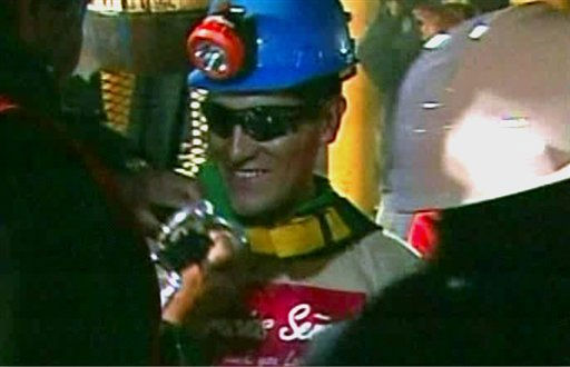 "<div class=""meta ""><span class=""caption-text "">In this screen grab taken from video, Carlos Mamani, the fourth miner to be rescued, celebrates after his rescue Wednesday, Oct. 13, 2010 at San Jose Mine near Copiapo, Chile. Mamani had just started working as a heavy-equipment operator at the mine when it it collapsed.  (AP Photo) (AP Photo/ DG**NY** MM**NY**)</span></div>"