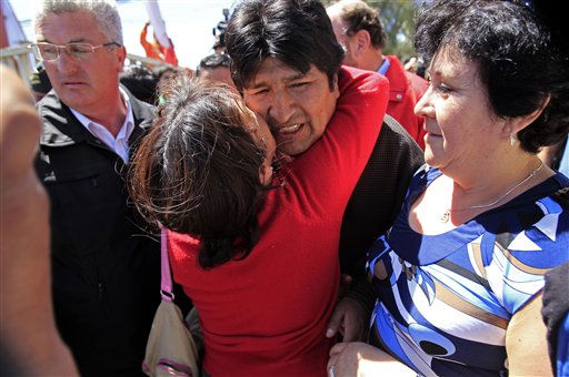 Bolivia&#39;s President Evo Morales, center back, is greeted  by a woman after visiting a hospital in Copiapo, Chile, Wednesday, Oct. 13, 2010. Morales paid a visit to the rescued miners from the San Jose mine who were trapped underground during more than two months, among them, Carlos Mamani, a Bolivian citizen. &#40;AP Photo&#47;Martin Mejia&#41; <span class=meta>(AP Photo&#47; Martin Mejia)</span>