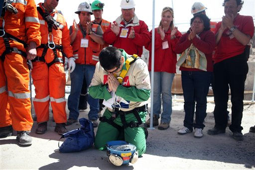 In this photo released by the Chilean government, miner Esteban Rojas, 44, gets on his knees to pray after being rescued from the collapsed San Jose gold and copper mine, near Copiapo, Chile, Wednesday, Oct. 13, 2010. Rojas was the eighteenth of the 33 miners rescued from the mine after more than two months trapped underground. &#40;AP Photo&#47;Hugo Infante, Chilean government&#41; <span class=meta>(AP Photo&#47; Hugo Infante)</span>