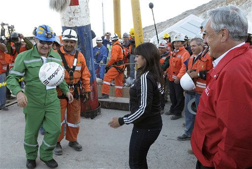 In this photo released by the Chilean Presidential Press Office, miner Franklin Lobo, left, a former professional soccer player, plays with a soccer ball as his daughter Carolina, center, and Chile&#39;s President Sebastian Pinera, right, looks on after he was rescued from the collapsed San Jose gold and copper mine where he had been trapped with 32 other miners for over two months near Copiapo, Chile, Wednesday Oct. 13, 2010.   &#40;AP Photo&#47;Alex Ibanez, Chilean Presidential Press Office&#41; <span class=meta>(AP Photo&#47; Alex Ibanez)</span>