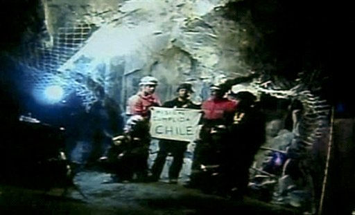 In this screen grab taken from video, rescuers inside the San Jose Mine near Copiapo, Chile, hold a sign that reads &#34;Mission Complete&#34; in Spanish after all 33 trapped miners were rescued Wednesday, Oct. 13, 2010. &#40;AP Photo&#41; <span class=meta>(AP Photo&#47; DG DG**NY**)</span>