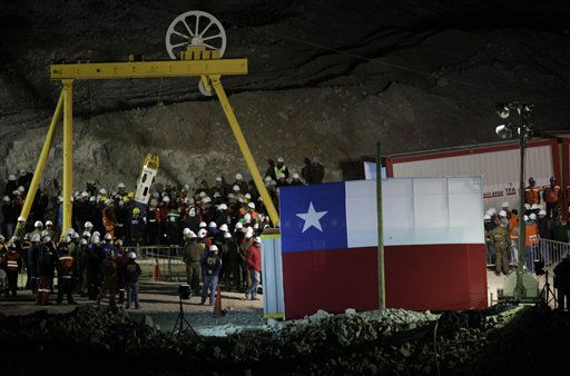 The capsule carrying the last rescued miner, Luis Urzua, emerges at the San Jose mine near Copiapo, Chile, Wednesday Oct. 13, 2010. The 69-day underground ordeal reached its end Wednesday night after 33 trapped miners were hauled up in a cage through a narrow hole drilled through 2,000 feet of rock.  &#40;AP Photo&#47;Roberto Candia&#41; <span class=meta>(AP Photo&#47; Roberto Candia)</span>