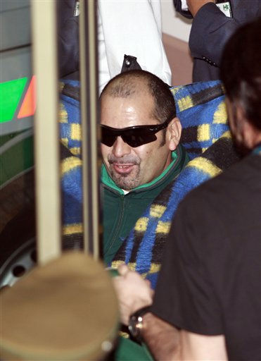 Rescued miner Mario Sepulveda arrives to the hospital in Copiapo, Chile, early Wednesday Oct. 13, 2010.  Sepulveda was the second of 33 miners to be rescued from the San Jose mine after more than 2 months trapped underground. &#40;AP Photo&#47;Dario Lopez-Mills&#41; <span class=meta>(AP Photo&#47; Dario Lopez-Mills)</span>