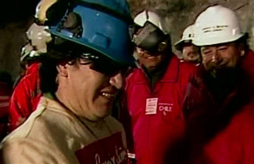In this screen grab taken from video, Osman Araya, the sixth miner to be rescued, celebrates after his rescue Wednesday, Oct. 13, 2010 at San Jose Mine near Copiapo, Chile.  &#40;AP Photo&#41; <span class=meta>(AP Photo&#47; DG**NY** MM**NY**)</span>