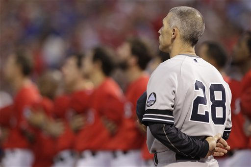 "<div class=""meta image-caption""><div class=""origin-logo origin-image ""><span></span></div><span class=""caption-text"">New York Yankees manager Joe Girardi before Game 1 of baseball's American League Championship Series against the Texas Rangers Friday, Oct. 15, 2010, in Arlington, Texas. (AP Photo/Tony Gutierrez) (AP Photo/ Tony Gutierrez)</span></div>"