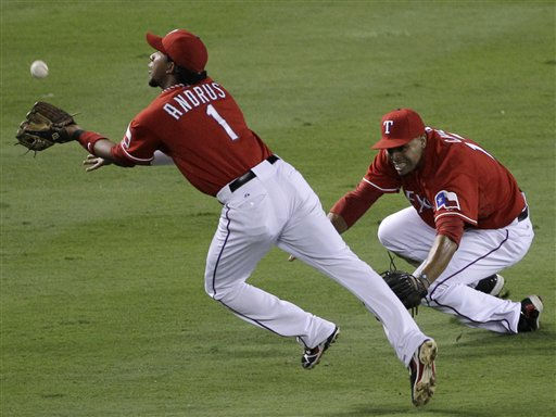 Texas Rangers shortstop Elvis Andrus &#40;1&#41; catches a fly ball by New York Yankees&#39; Robinson Cano in front of right fielder Nelson Cruz in the second inning of Game 1 of baseball&#39;s American League Championship Series Friday, Oct. 15, 2010, in Arlington, Texas. &#40;AP Photo&#47;Paul Sancya&#41; <span class=meta>(AP Photo&#47; Paul Sancya)</span>
