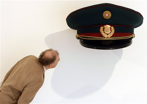 "<div class=""meta ""><span class=""caption-text "">A visitor looks underneath the exhibit ""Polizeikappe"" (police cap) by Austrian artist Erwin Wurm from 2010 at the Essl museum, in Klosterneuburg near Vienna, Austria, Tuesday, Oct. 19, 2010. The exhibition called ""Private Wurm"" runs from Oct. 20, 2010 to Jan. 30, 2011.  ((AP Photo/Ronald Zak))</span></div>"