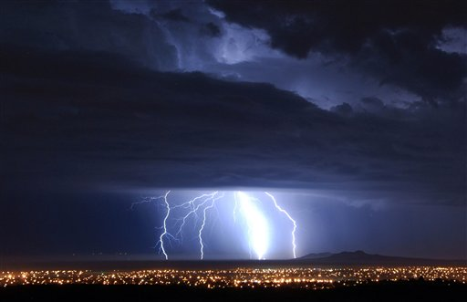 "<div class=""meta ""><span class=""caption-text "">Lightning strikes over Palmdale, Calif., early Tuesday Oct. 19, 2010 as a low pressure system brings unsettled wet weather to Southern California.  ((AP Photo/Mike Meadows))</span></div>"