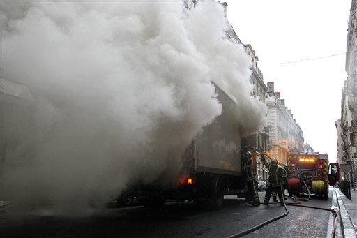 Firefighters put out a fire of a burning truck after clashes between the police and youth, in Lyon, central France, Wednesday Oct. 20, 2010. French authorities forced strike-shuttered fuel depots to reopen to ensure gasoline supplies, and the interior minister threatened Wednesday to send in paramilitary police to stop rioting on the fringes of protests against raising the retirement age to 62. Months of largely peaceful demonstrations against the pension reform have taken a violent turn in recent days. <span class=meta>( &#40;AP Photo&#47;Laurent Cipriani&#41;)</span>