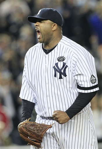 New York Yankees starting pitcher CC Sabathia reacts after striking out Texas Rangers&#39; Mitch Moreland to end the top of the sixth inning in Game 5 of baseball&#39;s American League Championship Series Wednesday, Oct. 20, 2010, in New York.  <span class=meta>(&#40;AP Photo&#47;Charles Krupa&#41;)</span>