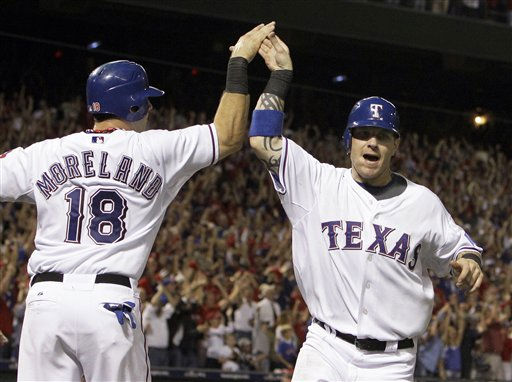 Texas Rangers&#39; Mitch Moreland &#40;18&#41; greets Josh Hamilton after both scored on a double by Vladimir Guerrero in the fifth inning of Game 6 of baseball&#39;s American League Championship Series against the New York Yankees Friday, Oct. 22, 2010, in Arlington, Texas. &#40;AP Photo&#47;Chris O&#39;Meara&#41; <span class=meta>(AP Photo&#47; Chris O&#39;Meara)</span>