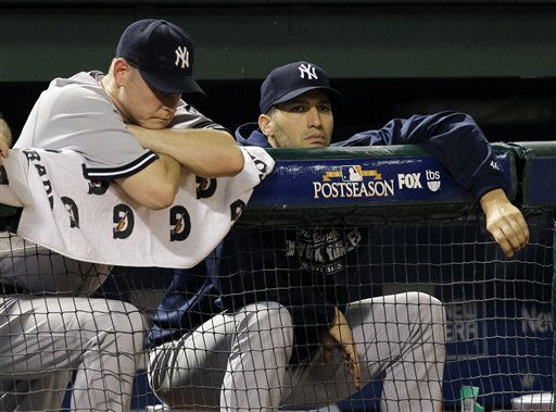 "<div class=""meta image-caption""><div class=""origin-logo origin-image ""><span></span></div><span class=""caption-text"">New York Yankees relief pitcher Kerry Wood, left, and starting pitcher Andy Pettitte hang on the dugout rail in the eighth inning of Game 6 of baseball's American League Championship Series against the Texas Rangers Friday, Oct. 22, 2010, in Arlington, Texas. (AP Photo/Chris O'Meara) (AP Photo/ Chris O'Meara)</span></div>"