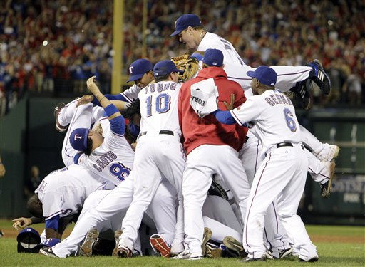 Texas Rangers players celebrate after a 6-1 over the New York Yankees win in the deciding Game 6 of baseball&#39;s American League Championship Series Friday, Oct. 22, 2010, in Arlington, Texas. &#40;AP Photo&#47;Chris O&#39;Meara&#41; <span class=meta>(AP Photo&#47; Chris O&#39;Meara)</span>
