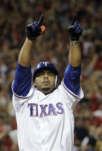 "<div class=""meta image-caption""><div class=""origin-logo origin-image ""><span></span></div><span class=""caption-text"">Texas Rangers' Nelson Cruz celebrates after a two-run home run off New York Yankees relief pitcher David Robertson in the fifth inning of Game 6 of baseball's American League Championship Series Friday, Oct. 22, 2010, in Arlington, Texas. (AP Photo/Chris O'Meara) (AP Photo/ Chris O'Meara)</span></div>"