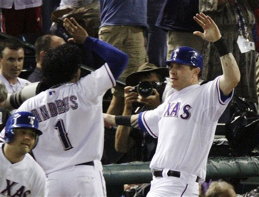 Texas Rangers&#39; Josh Hamilton, right, celebrates with Elvis Andrus &#40;1&#41; after Hamilton scored on Vladimir Guerrero&#39;s two-run double against the New York Yankees in the fifth inning of Game 6 of baseball&#39;s American League Championship Series Friday, Oct. 22, 2010, in Arlington, Texas. &#40;AP Photo&#47;Mark Humphrey&#41; <span class=meta>(AP Photo&#47; Mark Humphrey)</span>