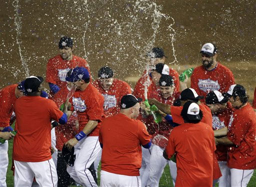 "<div class=""meta ""><span class=""caption-text "">Texas Rangers players spray champagne on the field after they advanced to the World Series with a 6-1 win over the New York Yankees in Game 6 of baseball's American League Championship Series Friday, Oct. 22, 2010, in Arlington, Texas. (AP Photo/Paul Sancya) (AP Photo/ Paul Sancya)</span></div>"