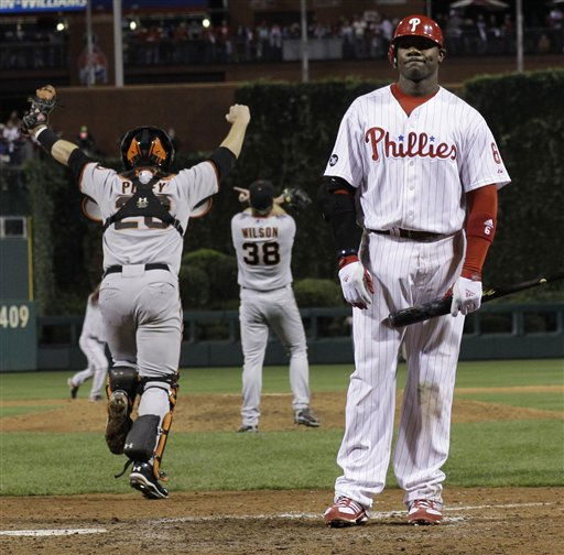 The San Francisco Giants rush the field as Philadelphia Phillies&#39; Ryan Howard stands at home after the ninth inning of Game 6 of baseball&#39;s National League Championship Series Sunday, Oct. 24, 2010, in Philadelphia. The Giants won 3-2 to win the series and advance to the World Series against the Texas Rangers. &#40;AP Photo&#47;David J. Phillip&#41; <span class=meta>(AP Photo&#47; David J. Phillip)</span>