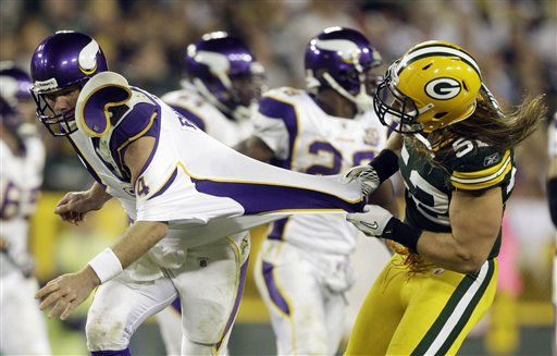 Green Bay Packers linebacker Clay Matthews tries to throw down Minnesota Vikings quarterback Brett Favre during the second half of an NFL football game Sunday, Oct. 24, 2010, in Green Bay, Wis. The Packers won 28-24. &#40;AP Photo&#47;Morry Gash&#41; <span class=meta>(AP Photo&#47; Morry Gash)</span>