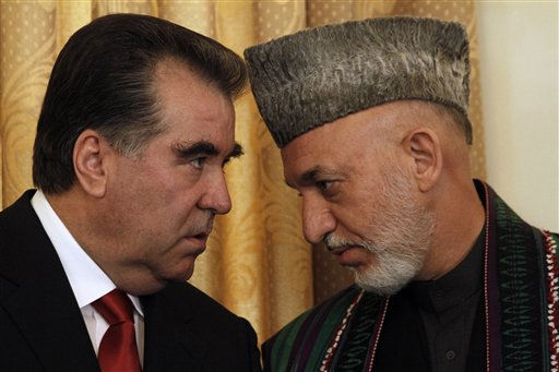 Afghan President Hamid Karzai talks to the President of Tajikistan Emomalii Rahmon in Kabul, Afghanistan, Monday, Oct. 25, 2010. Karzai told reporters Monday that once or twice a year Iran gives his office &#36;700,000 to &#36;975,000 for official presidential expenses. He said the U.S. has known about the Iranian assistance for years and that Washington also gives the palace &#34;bags of money.&#34;  &#40;AP Photo&#47;Allauddin Khan&#41; <span class=meta>(AP Photo&#47; Allauddin Khan)</span>