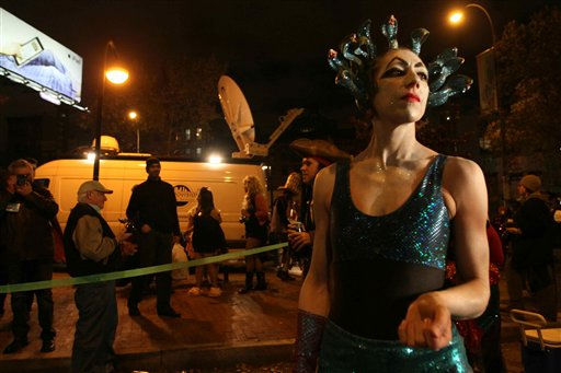 "<div class=""meta ""><span class=""caption-text "">Dressed as Medusa, Lisa Michurski dances as she waits to participate in the Village Halloween Parade Sunday, Oct. 31, 2010 in New York. (AP Photo/Tina Fineberg) (AP Photo/ Tina Fineberg)</span></div>"