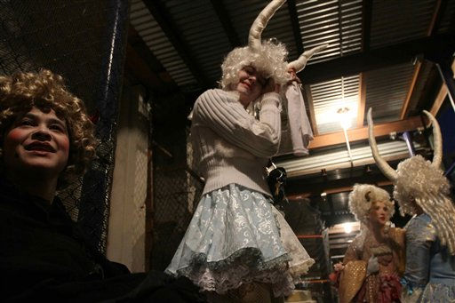Damaris Webb, left, and others wait in costume to in participate in the Village Halloween Parade Sunday, Oct. 31, 2010 in New York. &#40;AP Photo&#47;Tina Fineberg&#41; <span class=meta>(AP Photo&#47; Tina Fineberg)</span>