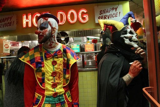 Dressed as a clown, Ariel Antigua, left, and others pass through an eatery along the route of the Village Halloween Parade following the parade Sunday, Oct. 31, 2010 in New York. &#40;AP Photo&#47;Tina Fineberg&#41; <span class=meta>(AP Photo&#47; TINA FINEBERG)</span>