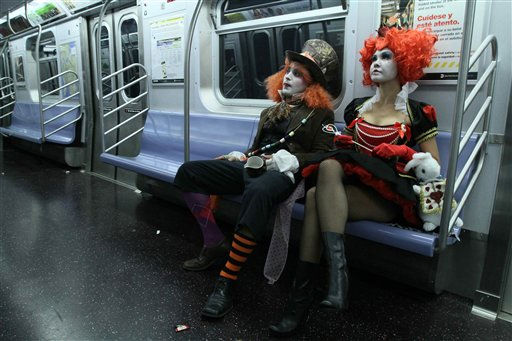 Alan Bonilla, dressed as the Mad Hatter, left, and his girlfriend Christine Sienicki, dressed as the Red Queen, take the subway after the Village Halloween Parade Sunday, Oct. 31, 2010 in New York. &#40;AP Photo&#47;Tina Fineberg&#41; <span class=meta>(AP Photo&#47; TINA FINEBERG)</span>