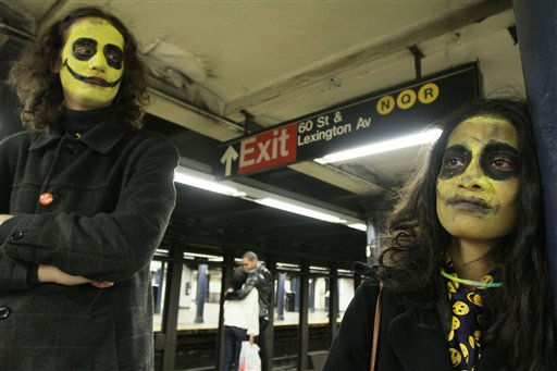 After attending the Village Halloween Parade earlier, Nenad Zagorac, left, and his girlfriend, Saima Shah, both from California, wait for a train in the subway early Monday morning Nov. 1 2010 in New York. &#40;AP Photo&#47;Tina Fineberg&#41; <span class=meta>(AP Photo&#47; Tina Fineberg)</span>