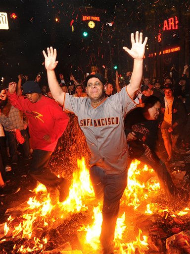 Giants fan Ron Galileo jumps through a bonfire outside AT&#38;T Park Monday, Nov. 1, 2010, in San Francisco after the Giants won the World Seriesd. &#40;AP Photo&#47;Noah Berger&#41; <span class=meta>(AP Photo&#47; Noah Berger)</span>