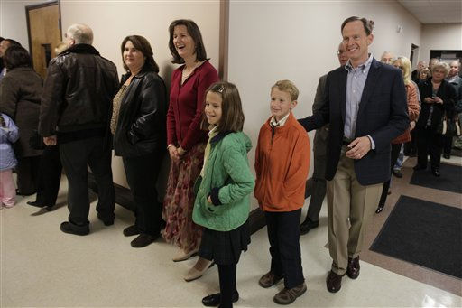 Pennsylvania Republican candidate for U.S. Senate Pat Toomey, right, waits in line to vote with his family, Patrick Toomey, 9, second from right, Bridget Toomey, 10, third from right, and his wife Kris Toomey, fourth from right, at the Upper Milford Township building in Zionsville, Pa., in the predawn hours of Tuesday, Nov. 2, 2010. &#40;AP Photo&#47;Carolyn Kaster&#41; <span class=meta>(AP Photo&#47; Carolyn Kaster)</span>