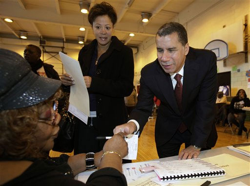 "<div class=""meta image-caption""><div class=""origin-logo origin-image ""><span></span></div><span class=""caption-text"">New York Gov. David Paterson is accompanied by his wife Michelle Paige Paterson, center, as he signs in to vote, in New York, Tuesday, Nov. 2, 2010. (AP Photo/Richard Drew) (AP Photo/ Richard Drew)</span></div>"