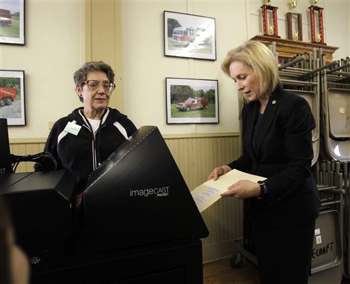 U.S. Sen. Kirsten Gillibrand, D-NY, right, has her ballot scanned as election inspector Marjorie Russell looks on, in Greenport, N.Y., Tuesday, Nov. 2, 2010. &#40;AP Photo&#47;Mike Groll&#41; <span class=meta>(AP Photo&#47; Mike Groll)</span>