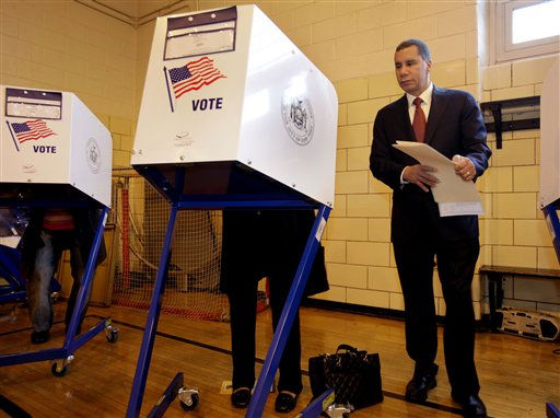 New York Gov. David Paterson stands by as his wife Michelle Paige Paterson casts her vote in New York, Tuesday, Nov. 2, 2010. &#40;AP Photo&#47;Richard Drew&#41; <span class=meta>(AP Photo&#47; Richard Drew)</span>