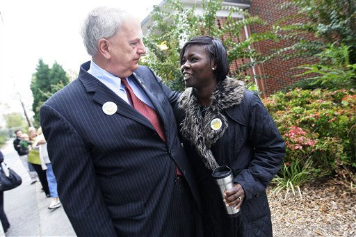 Georgia Democratic gubernatorial candidate Roy Barnes, left, stops to speak with first time voter Olubunkola Adegboye, right, after voting at Marietta Middle School in Marietta, Ga., on Tuesday, Nov. 2, 2010. AP Photo&#47;Josh D. Weiss <span class=meta>(AP Photo&#47; Josh D. Weiss)</span>