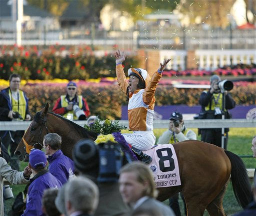 Lanfranco Dettori reacts after riding Dangerous Midge to victory during the Turf race at the Breeder&#39;s Cup horse races at Churchill Downs Saturday, Nov. 6, 2010, in Louisville, Ky. &#40;AP Photo&#47;Ed Reinke&#41; <span class=meta>(AP Photo&#47; Ed Reinke)</span>