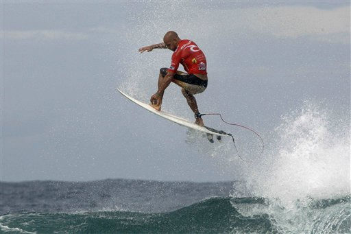 US surfer Kelly Slater, 38, from Florida, surfs to win his heat and claim his tenth World Championship title, a world record, at the 2010 Rip Curl Pro Search surfing championship in Isabela, northwestern Puerto Rico, Saturday, Nov. 6, 2010. &#40;AP Photo&#47;Ricardo Arduengo&#41; <span class=meta>(AP Photo&#47; Ricardo Arduengo)</span>