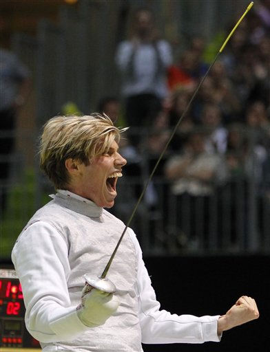 "<div class=""meta ""><span class=""caption-text "">Germany's Peter Joppich reacts as he defeats China's Lei Sheng in the men's single foil final during the fencing World Championships in Paris, Sunday Nov. 7, 2010. (AP Photo/Francois Mori) (AP Photo/ Francois Mori)</span></div>"