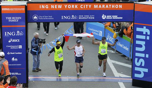 Chilean miner Edison Pena, center, crosses the finish line at the New York City Marathon in New York, Sunday, Nov. 7, 2010. &#40;AP Photo&#47;Seth Wenig&#41; <span class=meta>(AP Photo&#47; Seth Wenig)</span>