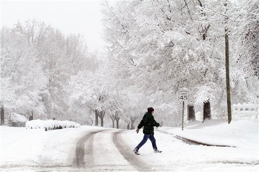 "<div class=""meta ""><span class=""caption-text "">Margaret Ness takes a morning walk through snow in Raleigh, N.C., Sunday, Dec. 26, 2010. (AP Photo/Jim R. Bounds) (AP Photo/ Jim R. Bounds)</span></div>"