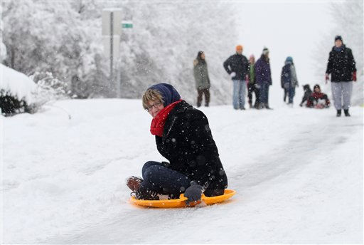Laurie Samet of Fort Lauderdale, Fla. sleds down city street in Raleigh, N.C., Sunday, Dec. 26, 2010. &#40;AP Photo&#47;Jim R. Bounds&#41; <span class=meta>(AP Photo&#47; Jim R. Bounds)</span>