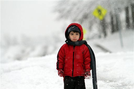 Clint Mesa, 7, waits to sled with his father Frank Mesa on a city street in Raleigh, N.C., Sunday, Dec. 26, 2010. &#40;AP Photo&#47;Jim R. Bounds&#41; <span class=meta>(AP Photo&#47; Jim R. Bounds)</span>