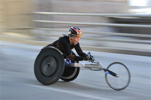 A wheelchair competitor speeds towards the down ramp of the Queensboro Bridge headed towards Manhattan during the New York City Marathon on Sunday, Nov. 7, 2010 in New York. &#40;AP Photo&#47;Kathy Kmonicek&#41; <span class=meta>(AP Photo&#47; Kathy Kmonicek)</span>